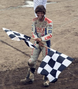 Guy Martin having fun with the chequered flags