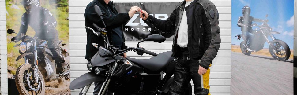 Fred Murphy collecting the UK's first electric bike to be sold with an OLEV 'plug in...