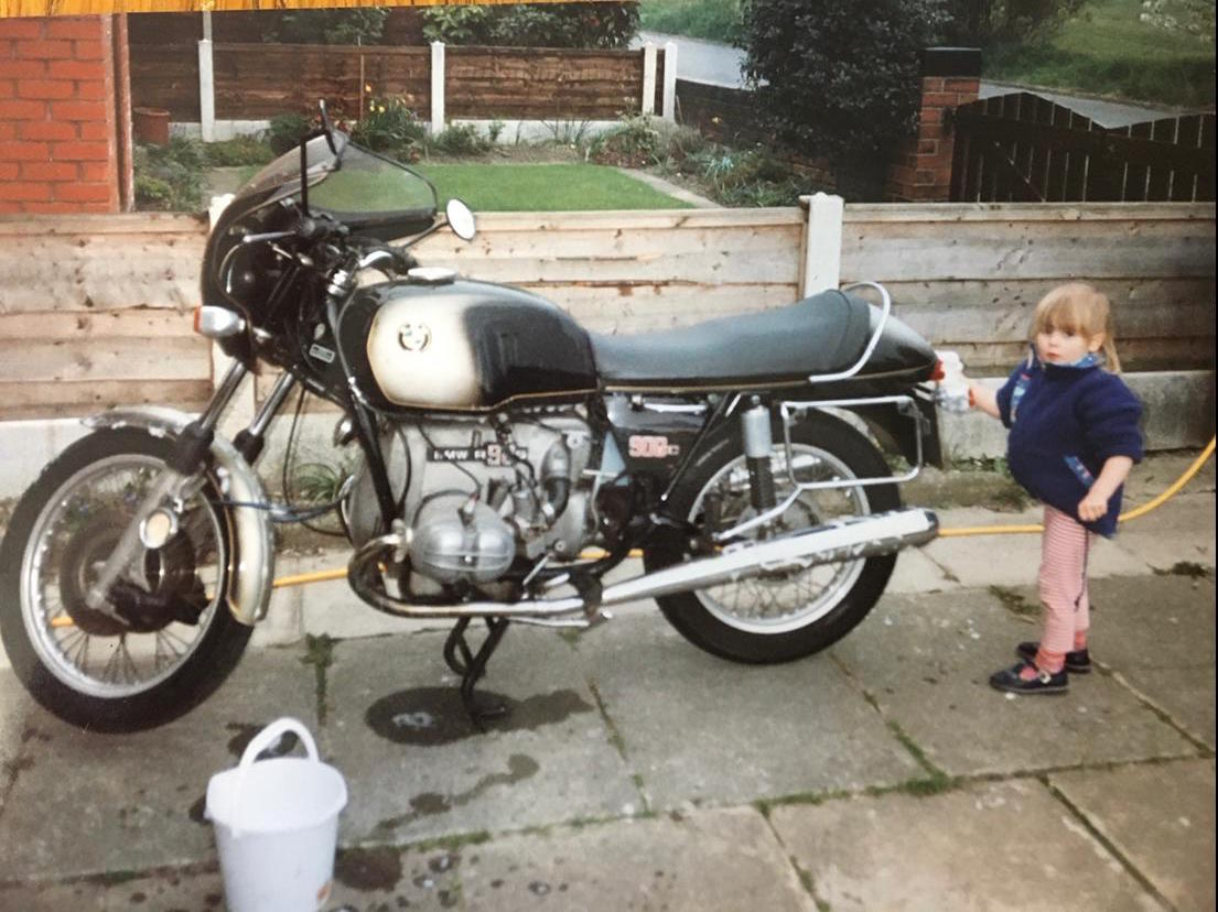 A young Username Kate cleaning her dad's motorbike.