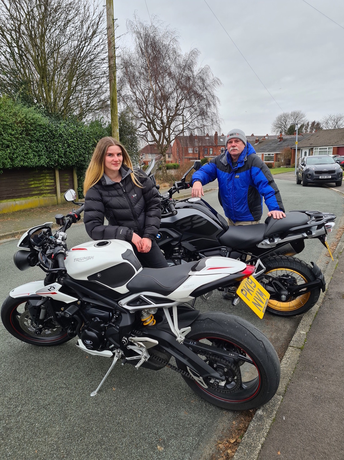 Kate with 'Username Dad' and their bikes