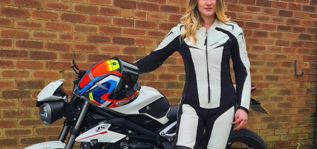 Kate Ralph in front of a motorbike