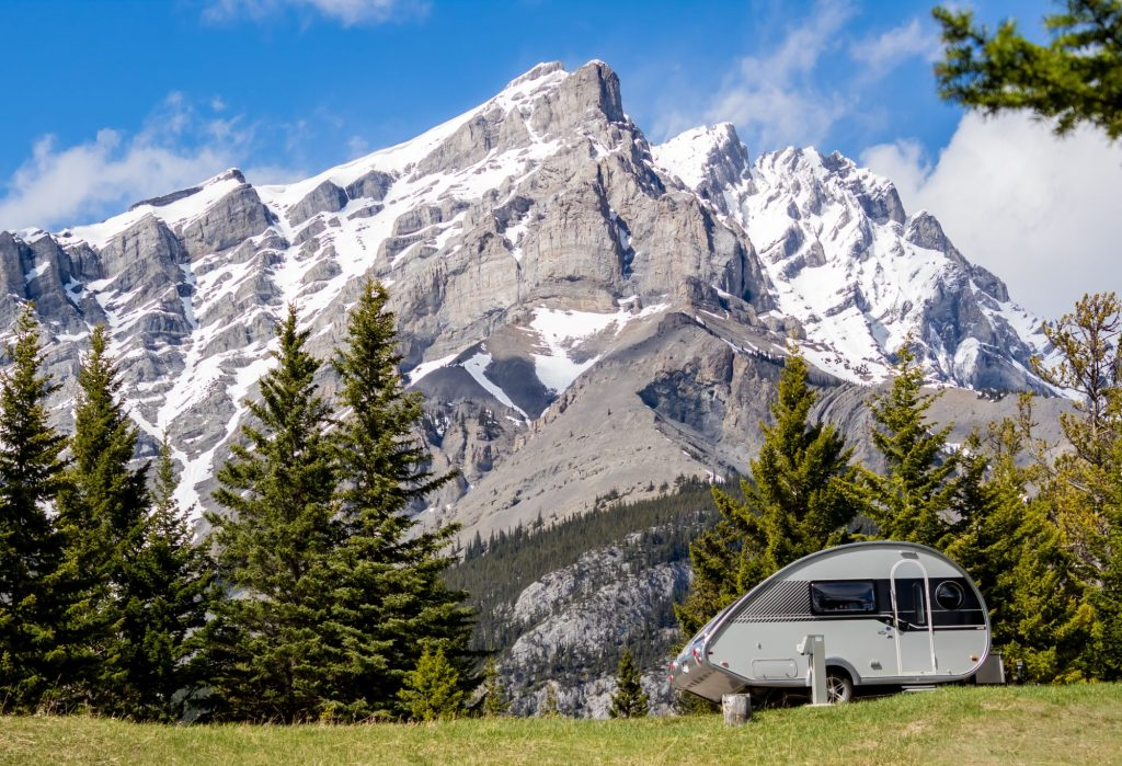 Scenic view of Tunnel mountain in Banff, Alberta with a small teardrop camper trailer in front