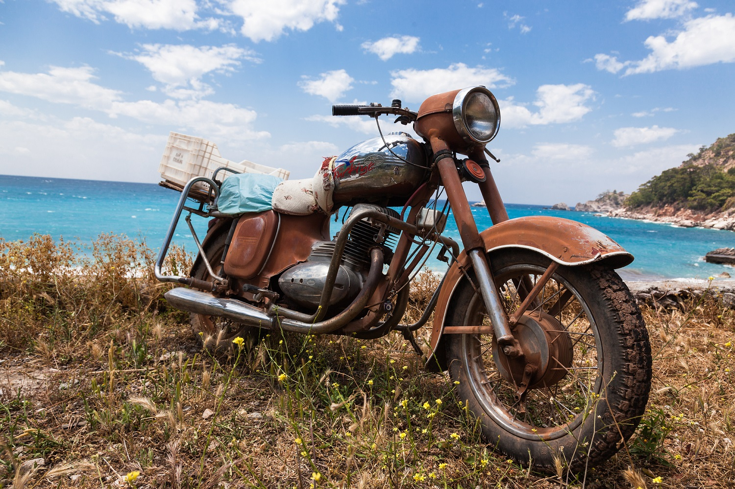 Rusty chrome motorcycle with sea in the background